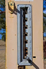 selector lever to determine the volume of petrol to pump into the calibrated glass cylinder on top of mechanical petrol pump (outback traveller) Tags: historic seq