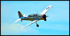 "Valiant Echoes - ""Grace"" (J Michael Hamon) Tags: airplane aircraft plane valiant vultee bt13 grace sky airshow stunt flying pilot wwii hamon d3200 nikon 55300mm nikkor columbusindiana aviationday aviation photoborder outdoor"