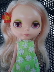Melody with a sweet flower in her hair and a super cute mod dress.