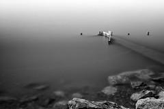 Portale Evanescenza (Roberto -) Tags: fog nebbia foschia pontile arenile jetty black white bianco nero long exposure lunga esposizione evanescence lake lago resia merano trentino alto adige italia