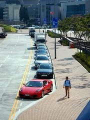 Nice car! (Mark Obusan) Tags: hk car hongkong spider pedestrian ferrari racing roadside 2008 carjack f430 publicparking carnap unprotected cenral rc8508
