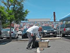 CambridgeManwTanBin (fotosqrrl) Tags: cambridge urban parkinglot mural farmersmarket massachusetts streetphotography bin centralsquare