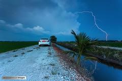 First Strike (abd. halim hadi) Tags: field paddy strike lightning tanjung sungai karang petir sireh kilat guruh ribut