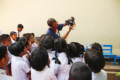 Sri Lanka, Colombo, Art in All of Us activities, teacher showing photos on back of camera (anthonyasael) Tags: camera school girls boy students girl horizontal digital asian fun photography photo education uniform asia day photographer image photos indian crowd picture teacher photograph workshop learning leisure digitalcamera srilanka teaching activity studying pupil colombo schooluniform primaryschool schoolboy animator backgroundpeople schoolfellow greenboard elementarystudent indiansubcontinent elementaryage classfellow schoolagechild