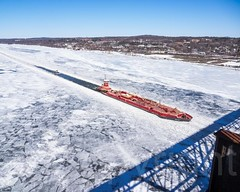Reinauer Twins Tugboat with Barge on the frozen Hudson River, Highland-Poughkeepsie, New York (jag9889) Tags: winter usa snow ny newyork ice river boat unitedstates unitedstatesofamerica aerialview poughkeepsie highland transportation tugboat hudsonriver tug barge waterway dutchesscounty 2015 workboat ulstercounty reinauer jag9889 20150312