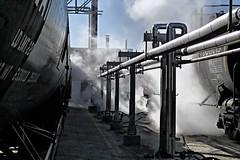 Steam and light at a rail transload site. (Chuck Wilson Photo) Tags: light train shadows tank rail naturallight steam railcar transportation tanker tankcar tanktrain canonxti tankrail