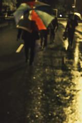 People know when to walk away..........!!! (www.wajidzeb.com) Tags: street light shadow people blur rain night umbrella walking bokeh nightphoto 1855mm canon60d