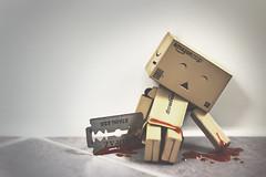 The razor blade strokes your skin... (Tommyfluegel) Tags: canon fun toy eos death blood amazon figur blut karton 50mm18ii danbo rasierklinge revoltech 60d danboard