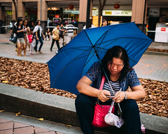 "Enjoying some ""me time"" (Sean Lowcay (sealow08)) Tags: street city blue portrait people umbrella asian singapore asia citylife streetphotography streetlife streetscene fujifilm streetphoto x100s"