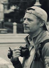 Photographer (Natali Antonovich) Tags: camera brussels portrait monochrome festival photographer belgium belgique belgie lifestyle stare sablon reverie ommegang photographercamera dezavel sweetbrussels magicianfriendcamera