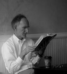 Reading by Morning Light (photo_secessionist) Tags: portrait informal man reading light cafe book blackwhite bw bn fredericksburg virginia square pentax km