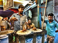 The Dosa Shop (arkamitra lahiricolour) Tags: portrait people food india colour face cuisine indian streetphotography streetscene motorola karnataka kolkata hdr calcutta dosa indianfood foodstall southindia shopkeeper dhosa g4plus