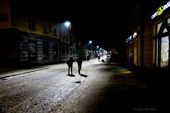 Tarnowskie Gry (nightmareck) Tags: tarnowskiegry lskie grnylsk silesia polska poland europa europe fotografianocna bezstatywu night handheld owietlenieledowe owietlenieled fujifilm fuji xe1 apsc xtrans xmount mirrorless bezlusterkowiec xf18mm xf18mmf20r fujinon pancakelens silhouette man woman human person people walk walking candid candidphotography darkness light humanelement