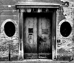 the door (marcobertarelli) Tags: door close bw contrast old medieval city treviso centre century light shadows detail subject material