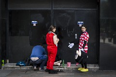 A Mickey Mouse Operation (Leanne Boulton) Tags: urban street candid streetphotography candidstreetphotography streetlife socialdocumentary sociallandscape man male woman female face faces facial expression mickeymouse minniemouse disney costume character performer beggar busker backstage dressing gesture tone texture detail depth reflection natural outdoor light shade shadow city scene human life living humanity society people culture canon 7d 50mm color colour glasgow scotland uk