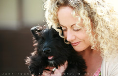 Puppy Love (John Twohig Photography) Tags: puppy dog scottie scottish terrier pup young furry squeeze love sweet cute new together blonde hair woman john twohig photography foylemedianet canon 5d 70200 awww curly beautiful pretty paw fur