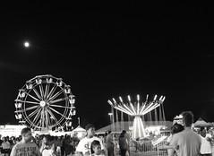 Harvest moon at Central Carolina Fair (collegemommy2012) Tags: harvestmoon fullmoon ferriswheel longexposure night nightsky nikonphotography nikon