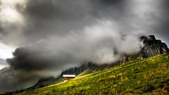 Weather Change (marco soraperra) Tags: alps house hat landscape fog mist clouds sky mountains field grass nature autumn october nikon nikkor
