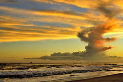 Spreading Warmth over the Sky (023134) (Mike S Perkins) Tags: ftmorgan landscape thunderhead clouds orange blue waves mar sea ocean coast beach alabama gulfshores gulfofmexico spiral