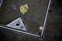 See a penny, pick it up..... (tootdood) Tags: canon70d stevenson square manchester see penny pick up grate leaf