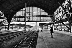 Praha Hlavni Nadrazi (Prague Main Train Station) (Dennis Rogers Photo) Tags: people urban blackandwhite texture architecture moody graphic prague platform tracks wideangle trainstation czechrepublic easterneurope prahahlavninadrazi