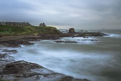 """Coastline"" (Theo.Triadafillos) Tags: ocean sea cliff storm green grass rock clouds coast scotland rocks edinburgh long waves exposer cliffs line coastline dunbar rugged"