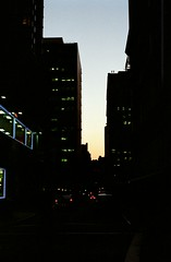 Silhouette (tomlangley) Tags: new york city nyc sky cars film silhouette 35mm buildings 50mm lights evening traffic