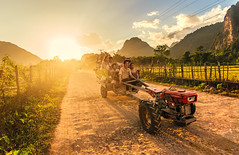 Farmers, Vang Vieng, Laos (syukaery) Tags: road street trip travel family sunset vacation people holiday tractor tourism rural asian countryside town nikon scenery asia warm village farmers d750 laos lao humaninterest laotian vsco