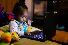 Daddy's Little Helper (Wamathaga) Tags: baby computer cuteness