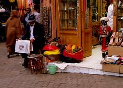 At Marrakech Suq (Armando Moreschi) Tags: people souvenirs morocco marocco marrakech mercato arabi suq giornale armandomoreschi