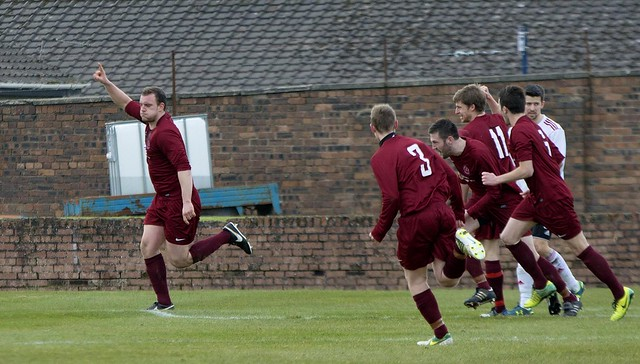 Chris Walker is pursued by his team-mates after heading Shotts two ahead