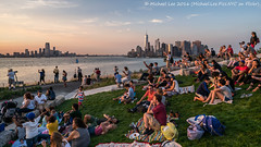 View from The Hills (DSC04308) (Michael.Lee.Pics.NYC) Tags: newyork governorsisland thehills 2016 sunset lowermanhattan jerseycity newyorkharbor lawn crowd waterfront cityscape sony a7rm2 zeissloxia21mmf28