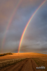 Rainbow Road (kevin-palmer) Tags: huntmountain bighornmountains bighornnationalforest august summer nikond750 evening sunset rainbow double dirt road clouds weather storm orange sunlight color colorful tamron2470mmf28