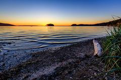 A Hole in the Island (Jeremy Carroll) Tags: water beach salish sunset washington sky bay island chuckanut places pnw driftwood bellingham sea unitedstates us