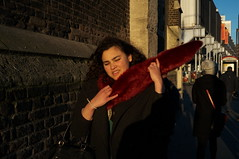 A fight with the red fur scarf (Gary Kinsman) Tags: red london scarf golden camden candid streetphotography streetlife swing frown camdentown struggle goldenhour nw1 camdenroad 2014 fujix100 fujifilmfinepixx100