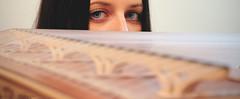 Eyes over the Kanun (Geo.M) Tags: bridge blue music girl beautiful lady canon eos eyes traditional rita indoors rings musical instrument shooting 1855mm efs picks georgios kanun γέφυρα 700d παραδοσιακό γεώργιοσ miliokas μηλιώκασ όργανο κανονάκι πένεσ μουσικό δακτυλήθρεσ