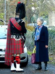 Unexpected meeting (badhands13) Tags: woman kilt scottish meeting bagpipes talking bagpiper tartan spats shoppingbags