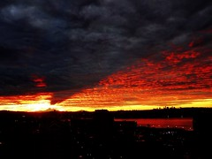 Mt Baker's cone-shaped shadow on this mornings burning sunrise sky (peggyhr) Tags: red sky urban orange usa canada black mountains yellow skyline vancouver clouds sunrise grey lights bc harbour silhouettes textures wa mountbaker thegalaxy 50faves peggyhr thegalaxyhalloffame rainbowofnaturelevel1red ♣myhatsofftoyou ♣scapes ♣mothernature coneshapedshadow dsc04914a