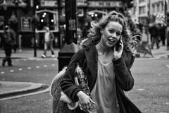 Beautiful blond girl - IMG_0320-Edit (roger_thelwell) Tags: life street city uk winter portrait england people urban bw white black streets cold london lamp girl monochrome beautiful westminster beauty hat rain leather mobile umbrella hair bag walking real photography mono chat shiny phone traffic post natural photos britain circus cigarette candid cab taxi great over sac hats cell photographic smoking lamppost photographs blond oxford conversation shiney talking shoulder handbag stud speak speaking studs commuters scak