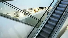 Empty moving staircase in trade center (greycoastmedia) Tags: motion up modern mall video interior empty escalator shoppingcentre indoor nobody down upstairs shoppingcenter downstairs tradecenter tradecentre footage movingstaircase movingstairway stockvideo greycoastmedia