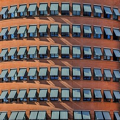 Dutch Heat Wave (Paul Brouns) Tags: sun building tower architecture photography europe shadows headquarters screen brickwall round rhythm zaandam ahold paulbrouns paulbrounscom