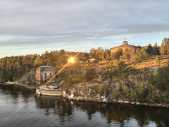 Setting sun reflection... (Sunday Money) Tags: sunset reflection stockholm sweden archipelago lensflare scandinavia fort fortress castle sun glare