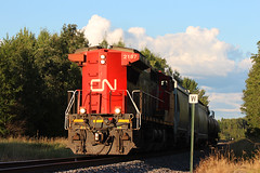 Luck (view2share) Tags: cn2187 cn canadiannational august72016 august2016 august 2016 ruskcounty wi wisconsin ge generalelectric c408w longhoodforward backward summer local engine locomotive barronsub westbound westernwisconsin railway railroading rr railroads rail rails railroaders rring railroad restoration renovation rebuild rural trains train track transportation tracks transport trackage trees freight freighttrain freightcar freightcars fracsand frac deansauvola evening afternoon branchline branch weyerhaeuser canyonroad