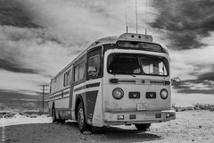 Lost bus (Carrot Room) Tags: monochrome bus desert joshua tree clouds abandonned rust