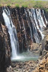 View on Zambian side (www.JnyAroundTheWorld.com - Pictures & Travels) Tags: vicfalls victoriafalls zimbabwe africa zambianside dryseason waterfalls landscape nature 7wonders naturalwonder falls cascade cascades canon jnyaroundtheworld jenniferlavoura