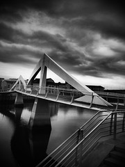 Squiggly Bridge (creditflats) Tags: white storm black reflection water clouds pen river grey scotland clyde glasgow stormy olympus calm squiggly brigde ep5 tradeston