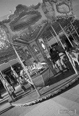Carrusel (williamjct86) Tags: street bw espaa byn blancoynegro photo blackwhite calle andaluca spain nikon foto streetphotography photograph cadiz fotografia andalusia emotions nikonf nikonfm2 chiclana fm2 tiovivo streetphotograph youngers fotografiacallejera