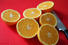 still life with halved oranges (oana-emilia) Tags: red stilllife orange macro kitchen closeup fruit knife fresh oranges reds tabletop image2100 100xthe2015edition 100x2015