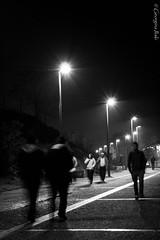 (Georgina ♡) Tags: people walking nightshot streetlamps cobblestones