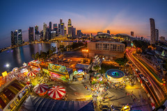 River Hongbao 2015 (BP Chua) Tags: park longexposure sunset people orange water colors beautiful marina canon river landscape amusement singapore colorful glow view display district spin central wideangle bluesky fisheye business human esplanade cbd lantern bp merrygoround fullerton bulidings chua swissotel hongbao birdeye marinabay 2015 marinabaysingapore 5dmark2 815mm